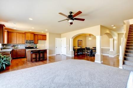 Photo pour New home kitchen interior and large empty living room  - image libre de droit