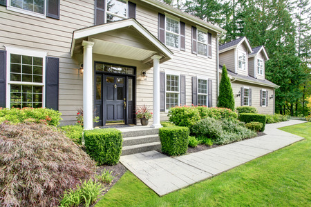 Photo for Large american classic house with column porch and walkway - Royalty Free Image