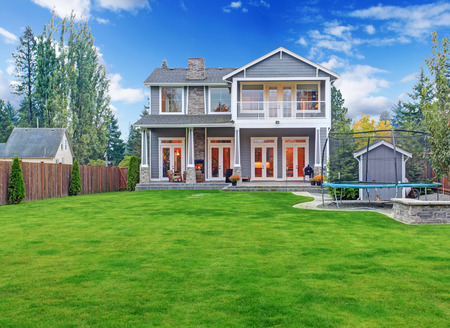 Luxury house with backyard walkout deck and tramploline on the ground