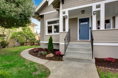 Photo for House exterior with entrance porch. View of staircase and front yard landscape - Royalty Free Image