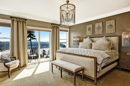Foto de Luxury bedroom interior with rich furniture and scenic view from walkout deck - Imagen libre de derechos