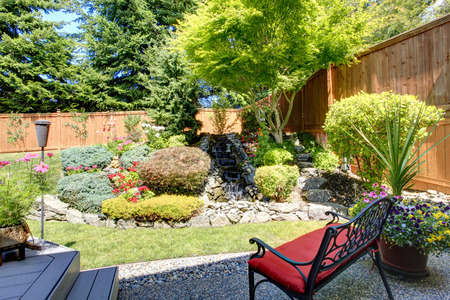 Photo pour Beautiful landscape design for backyard garden with small bench - image libre de droit