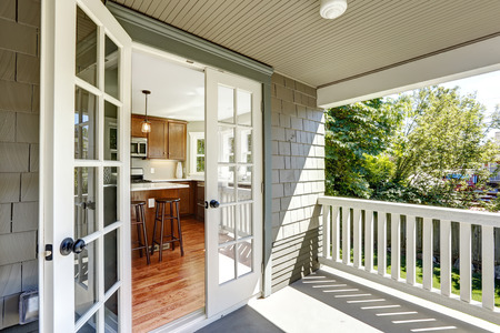 Photo pour Kitchen room with exit to walkout deck with railings. - image libre de droit