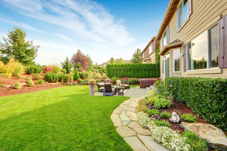 Foto de Impressive backyard landscape design with cozy patio area - Imagen libre de derechos