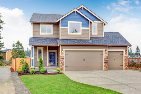 Photo for Beautiful traditional home with garage and driveway. - Royalty Free Image