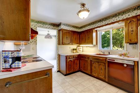 Foto de Empty simple old kitchen with tile flooring and vintage cabinets in American rambler. Northwest, USA - Imagen libre de derechos