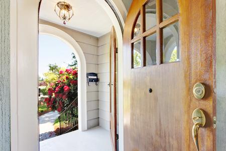 Foto de Nice bright entry way to home with concrete porch area and old sharpen door. Northwest, USA - Imagen libre de derechos