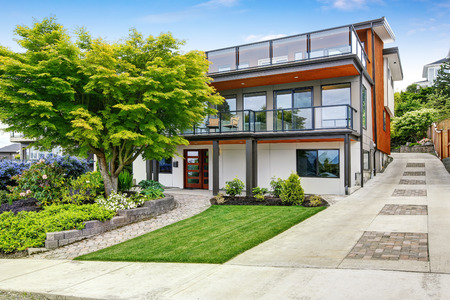 Foto de Modern three level house exterior with wooden trim and spacious two balconies areas. Northwest, USA - Imagen libre de derechos