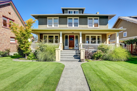 Photo for Nice curb appeal of American craftsman style house. Column porch view and well kept lawn in the front. Northwest, USA - Royalty Free Image