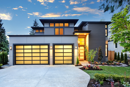 Foto für Beautiful exterior of contemporary home with two car garage spaces at sunset. Northwest, USA - Lizenzfreies Bild