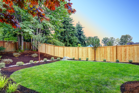 Foto de View of an attractive backyard with new planting beds and well kept lawn. Northwest, USA - Imagen libre de derechos