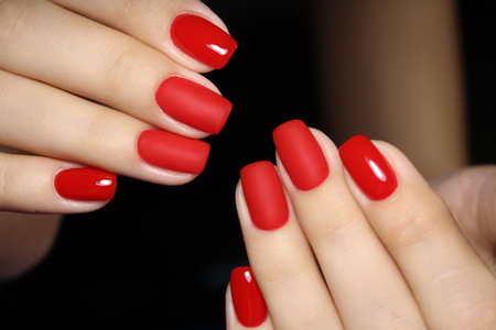 Photo for fashionable red manicure on long beautiful nails - Royalty Free Image