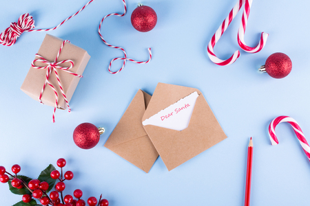 Foto per Letter to Dear Santa. Craft envelopes on christmas holiday background. Flat lay. - Immagine Royalty Free