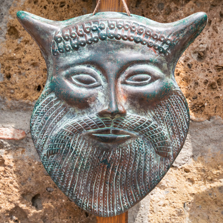Photo for Typical ancient Etruscan mask made of hand-worked bronze. - Royalty Free Image