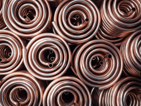Photo for Heat exchangers obtained by winding copper pipe. - Royalty Free Image