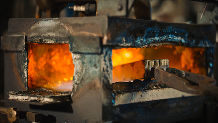Photo for Detail of a furnace where a piece of metal is heated to be worked. - Royalty Free Image