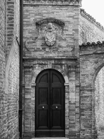 Photo for University Entrance with written on the door: Free University of Urbino, Faculty of Law. Urbino, Italy. - Royalty Free Image