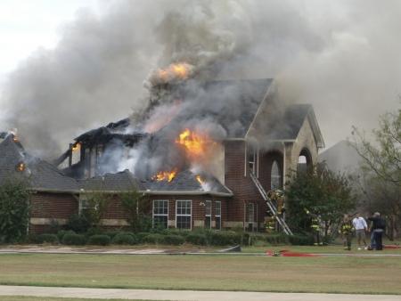 Firemaen responding to house fire