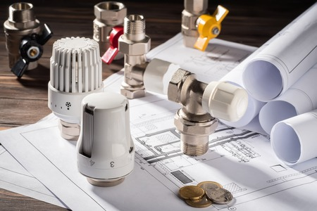 Foto de Thermostatic Head Valve for Radiator Heater Coin Money notepad for entries Heating Project Boiler room house Heat Supply Building Concept of Energy saving and conservation to pay for public service. - Imagen libre de derechos