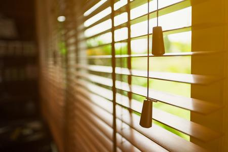 Foto de Wooden blinds with sun light. - Imagen libre de derechos