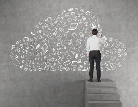 Photo pour young businessman drawing business icon in form cloud - image libre de droit