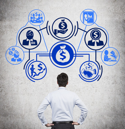 Foto de businessman looking on drawing business plan with icons - Imagen libre de derechos