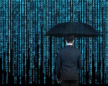 Photo pour businessman with umbrella  who is appeared through the matrix background - image libre de droit