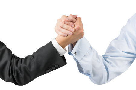 Foto de businessmen engaged in arm wrestling - Imagen libre de derechos