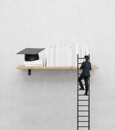 Photo pour Businessman climbs the stairs on shelf, mba concept - image libre de droit