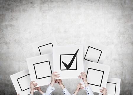 Foto de hands holding poster with drawing check box - Imagen libre de derechos