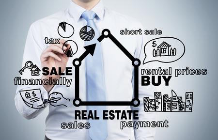 Photo pour businessman drawing real estate concept on blue background - image libre de droit