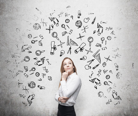 Photo pour Young beautiful business woman is thinking about optimisation business process. Drawn business icons over the concrete wall. - image libre de droit
