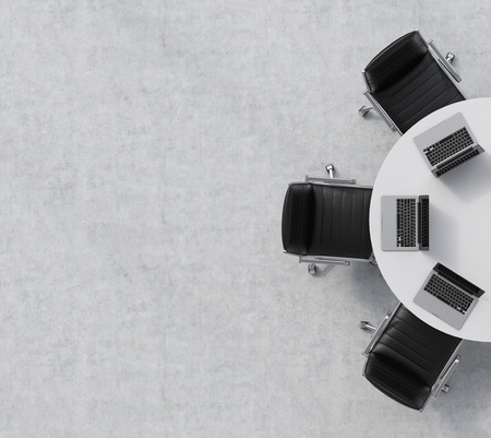 Foto de Top view of a half of the conference room. A white round table, three black leather chairs. Three laptops are on the table. Office interior. 3D rendering. - Imagen libre de derechos