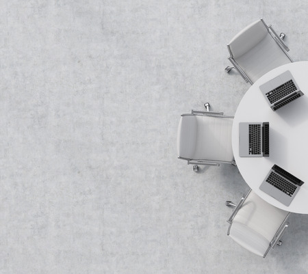 Foto de Top view of a half of the conference room. A white round table, three white leather chairs. Three laptops are on the table. Office interior. 3D rendering. - Imagen libre de derechos
