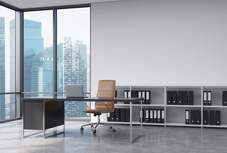Photo pour A CEO workplace in a modern corner panoramic office with Singapore city view. A black desk with a laptop, brown leather chair and a bookshelf with black document folders. 3D rendering. - image libre de droit