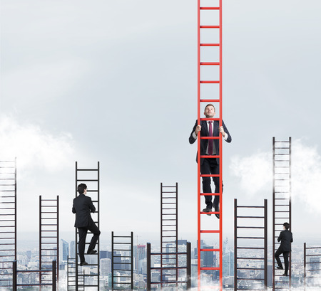 Photo pour A concept of competition, and problem solving. Several businessmen are racing to achieve the highest point using ladders. New York city view. - image libre de droit