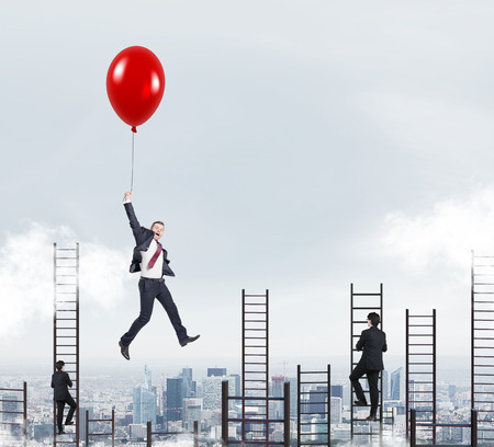Photo pour businessman in a suit flying happily holding a balloon over Paris, men climbing ladders, concept of success and career growth - image libre de droit