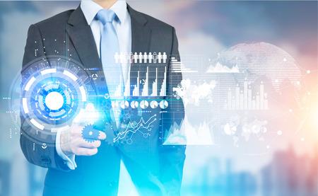 Foto de Businessman pointing at new hi-tech business panel on blurry city background. Virtual technology concept - Imagen libre de derechos