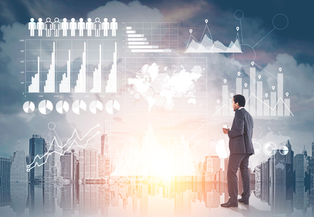 Photo for African American businessman holding a cup of coffee and looking at graphs in the sky. Cityscape background. Mock up toned image double exposure. Elements of this image furnished by NASA - Royalty Free Image