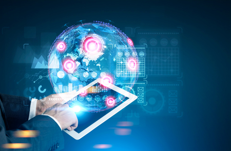 Foto de Close up of a hand of a man holding a tablet computer and interacting with graphs, HUD and holograms. Mock up toned image double exposure. Elements of this image furnished by NASA - Imagen libre de derechos