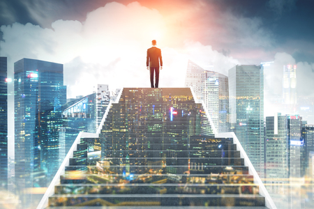 Photo for Rear view of a young businessman on the top of stairs. A magnificent modern city background. Night city in the foreground. Concept of a road to success. Toned image double exposure - Royalty Free Image