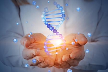 Foto de Unrecognizable woman with blond hair holding blue dna helix hologram. Biotech, biology, medicine and science concept. Double exposure toned image - Imagen libre de derechos