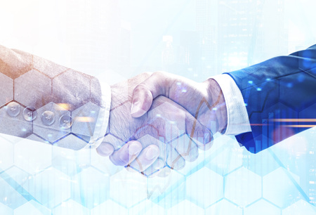 Close up of two businessmen shaking hands over blurred cityscape background with double exposure of graph and hexagonal pattern. Concept of partnership. Toned image