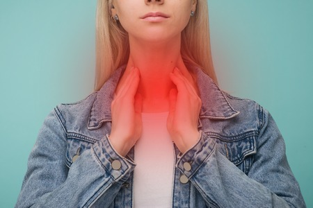 Foto für A young girl has a sore throat. Thyroid problems - Image - Lizenzfreies Bild