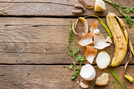 Foto de Food waste on a wooden background with space for text - Imagen libre de derechos