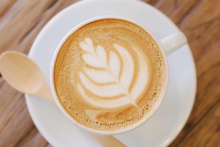 Photo pour Cup of coffee latte art on wood table - image libre de droit