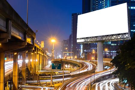 Foto de Blank billboard near expressway at night for advertisement. - Imagen libre de derechos