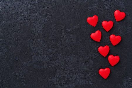 Photo for valentines day background red hearts on on black background - Royalty Free Image