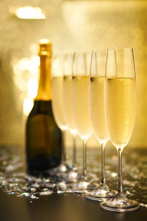 Photo for Many glasses of champagne in a line. Gold background - Royalty Free Image