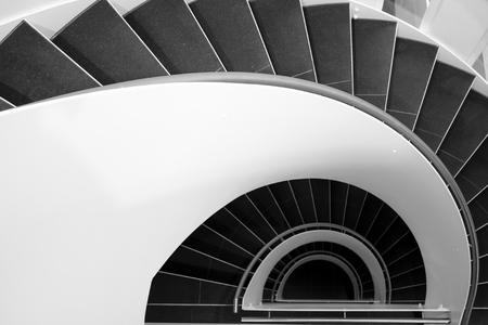 Foto de Spiral staircase in a modern building in black and white - Imagen libre de derechos